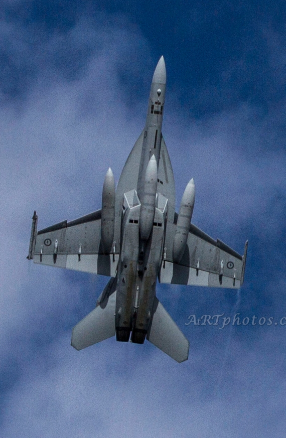 An F18 flying up.